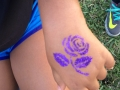 Stylish purple rose tattoo