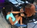 Black Widow applying a tattoo!