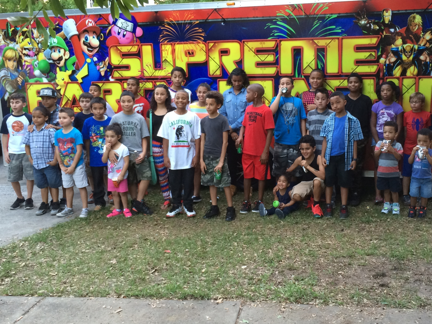 Group shot in front of the Supreme Party Machine